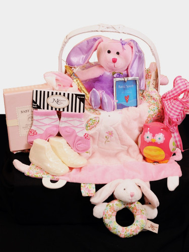 Baby Welcome Basket:   assortment of bunny-themed toys and gifts, including blanket, rattle, socks, plush toy, pewter frame, coin bank, and more.