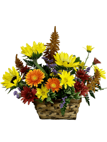 Harvest Basket:  arrangement of seasonal fall flowers such as sunflowers, gerbera, mums, and more, in a rectangular basket of dark willow
