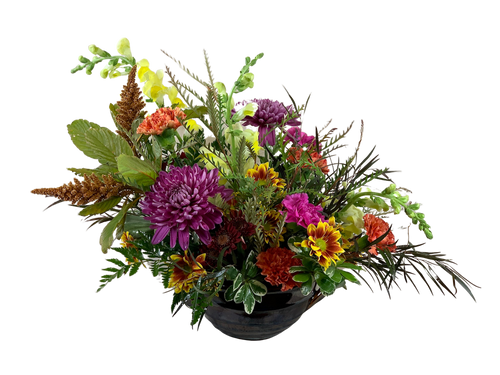 Exuberance Centerpiece:  bronze amaranthus, yellow snapdragons, purple mums, bicolor daisies, and orange and lavender daisies, with agonis foliage and variegated pittosporum, in a keepsake handled bowl of glazed terracotta