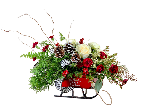 Sleigh Ride:  winter greens, branches, pinecones, berries, and flowers, in a keepsake sleigh container