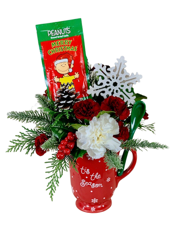Sweet Sips:  Arrangement of red and white flowers with winter greens in a keepsake holiday mug, with bonus package of hot chocolate mix