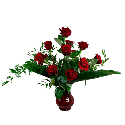 Modern Love:  One dozen red 'Finally' roses with curly willow, Italian ruscus, and aspidistra, in a glossy red vase.