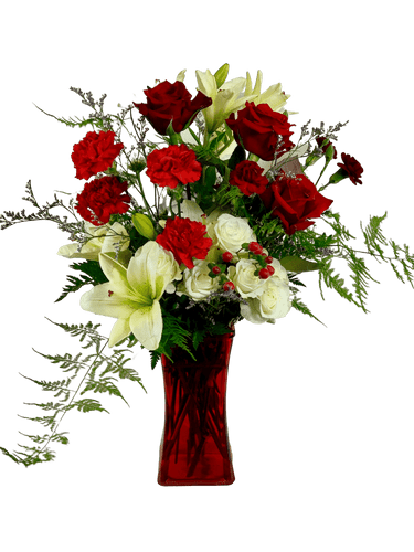 Fire and Ice:  Arrangement of red rose, red carnations, white lilies, and white spray roses, presented in a red glass gathering vase.