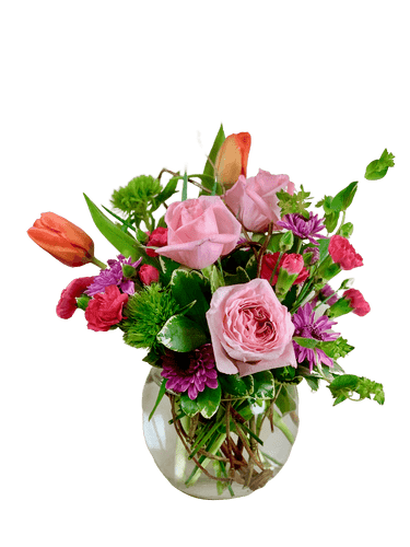 Blush of Spring:  Arrangement of pink roses, orange tulips, hot pink miniature carnations, and more, in a clear glass bubble bowl