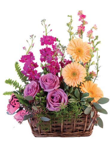 Sweet Meadows Basket:  lavender roses, peach gerbera, pink larkspur, and lavender stock, in a willow basket with a butterfly accent