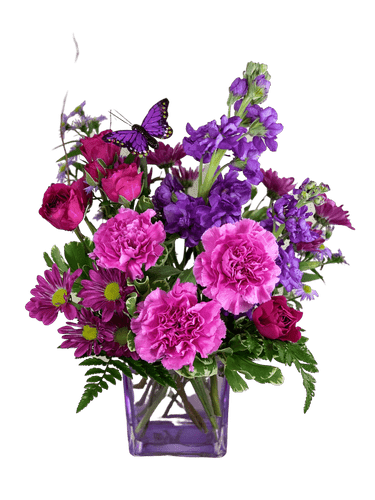Stomp the Grapes:  arrangement of purple spray roses, stock, carnations, and daisies in a cube of translucent lavender glass.