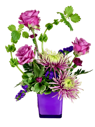 Captivating Lavender - arrangement of green Bells of Ireland, lavender roses, and bicolor spider mums, in a purple glass cube