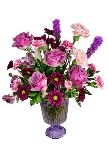Purple Passion:  arrangement of roses, liatris, alstromeria, carnations, and daisies, in shades of purple, presented in a footed compote dish of lavender pressed glass