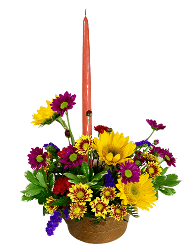 Autumn Gratitude - candle centerpiece of sunflowers, daisies, and carnations in shades of yellow red, and purple, presented in a round container of glazed earthenware