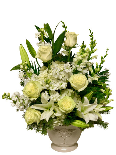 Peaceful Repose - tribute arrangement of white roses, snapdragons, stock, lilies, and hydrangea, in a white ceramic urn