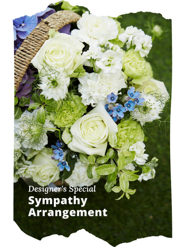 The Designer's Special Sympathy Arrangement includes the florist's choice of fresh blooms in a soft color palette, accented with seasonal greens, and beautifully presented for display in the funeral home, house of worship, or family home.