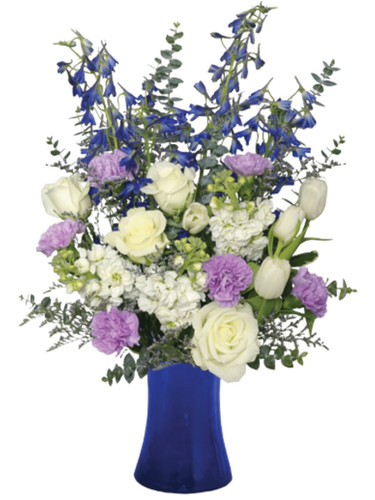 """Lullaby in Blue:"" Roses, tulips, delphinium, and more, in shades of blue, lavender, and white, arranged in a vase of cobalt blue glass."