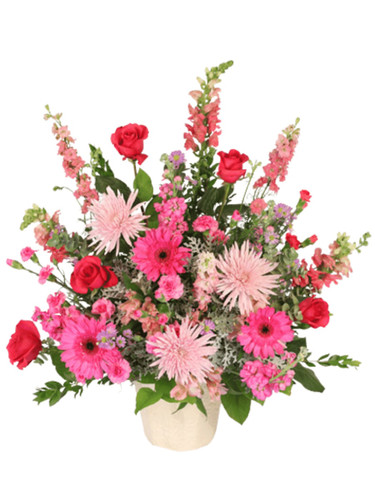 'Softly, Sweetly' - sympathy arrangement of roses, larkspur, snapdragons, gerbera, and more, in a classic memorial urn.