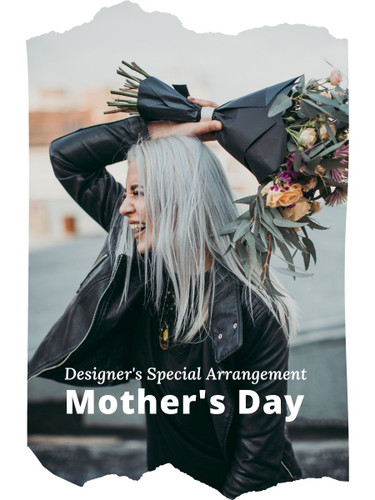 The Designer's Special Mother's Day Arrangement includes the florist's choice of fresh flowers in a classic color palette, accented with seasonal greens, and beautifully presented for the gift recipient.