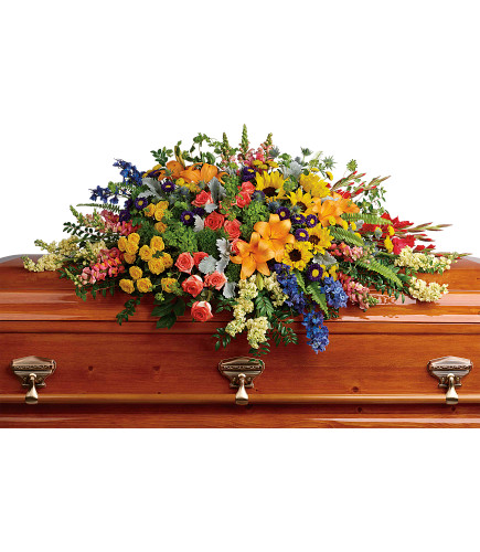 Colorful Reflections Casket Spray:  garden-style casket spray in vibrant colors, including such flowers as orange roses, red gladioli, and yellow sunflowers
