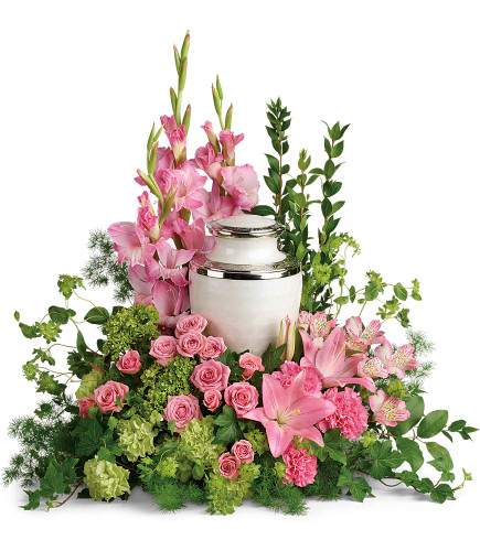 Sacred Solace Cremation Tribute Arrangement - floral arrangement for the cremation urn, including such flowers as pink gladioli, pink roses, pink lilies, and green hydrangea