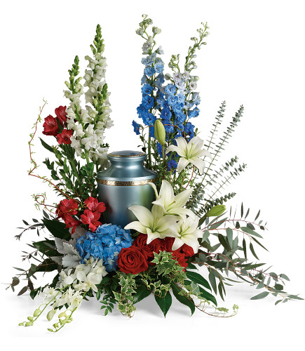 Reflections of Honor Cremation Tribute Arrangement - funeral floral arrangement for the cremation urn, including such flowers as red roses, white lilies, and blue hydrangea