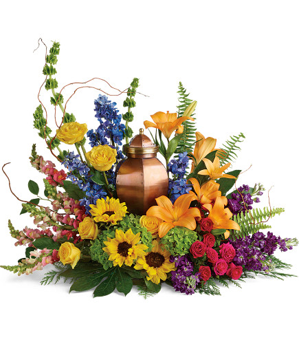 With All Our Hearts Cremation Tribute Arrangement - garden-style funeral arrangement for the cremation urn, including such flowers as yellow roses, orange lilies, and sunflowers