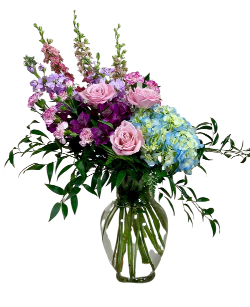 Rowing Along the Rancocas:  arrangement of pink larkspur, pink roses, blue hydrangea, and lavender stock in an 11-inch clear glass Ming vase