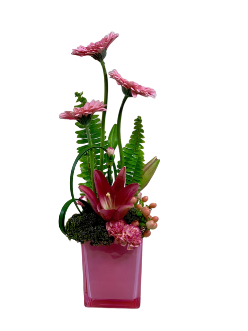 Power of Pink:  modern-style arrangement of pink gerbera and pink lilies in a pink glass cube