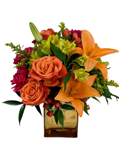 Trainwreck'd on Rum Punch:  arrangement of orange lilies, orange roses, hot pink carnations, solidago, and yellow alstromeria, in a gold mirrored glass cube