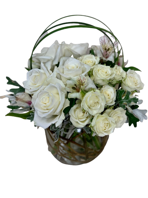 Tender Sentiments:  arrangement of white roses, spray roses, and alstromeria in a clear glass rose bowl