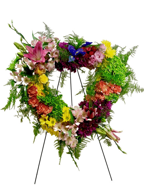 Garden Heart Wreath:  Heart-shaped sympathy wreath with brightly colored flowers