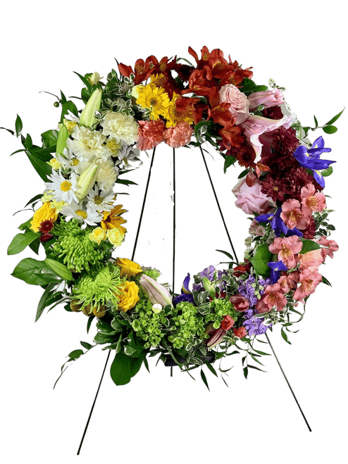 Hues of Hope:  vibrant sympathy wreath in rainbow colors
