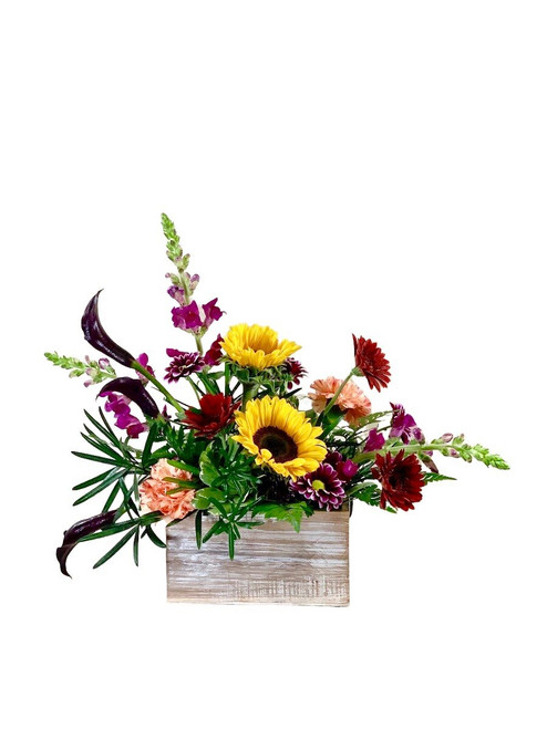 Falling for You:  autumn arrangement of purple snapdragons, eggplant calla, sunflowers, and more, in a wooden planter box