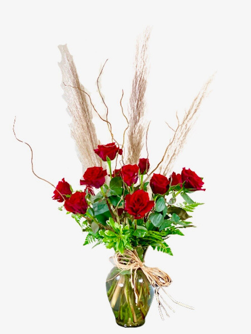 Wild at Heart:  one dozen red roses with pampas grass, curly willow, and greens, with raffia trim