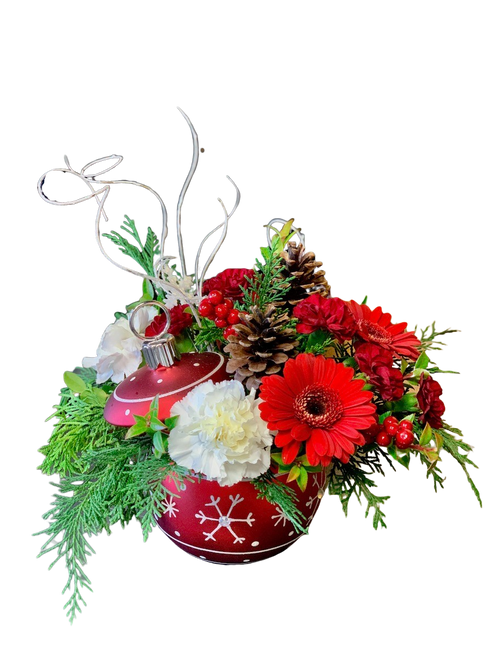 Simply Snowflakes Ornament:  red and white flowers with winter greens, pincones, and glittered branches, in a red keepsake ornament patterned with white snowflakes