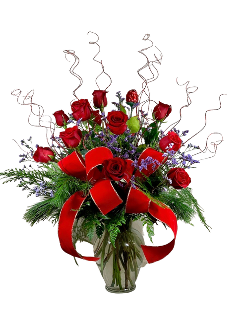 The Engagement Dozen - twelve premium long-stemmed red roses, with holiday greens, lots of sparkle, a luxurious velvet ribbon, and a chocolate rose