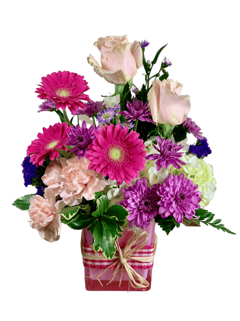 Ballet Slippers:  arrangement of pink roses, pink gerbera, white hydrangea, and more, in a pink glass cube with a gingham ribbon