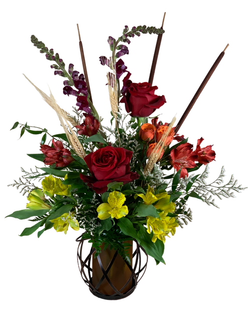 Bonfire's Glow:  arrangement of fall flowers in shades of red, orange, and yellow, presented in a keepsake lantern container