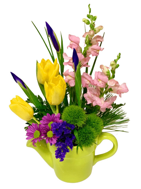 Spring Garden:  snapdragons, tulips, iris, and more, in shades of pink, yellow, and purple, presented in a ceramic watering can
