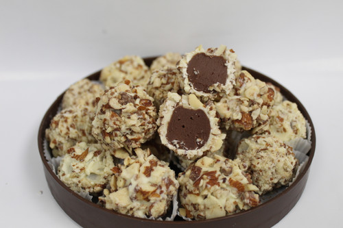 Our Homemade Chocolate Amaretto Fudge dipped in White Chocolate and rolled in Salty Almonds!