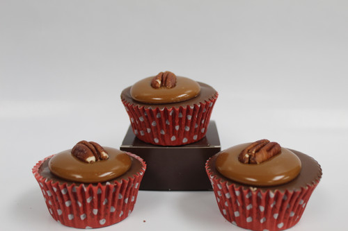 Our Handmade Pecan Turtle fudge the size of a cupcake topped with gooey Caramel!