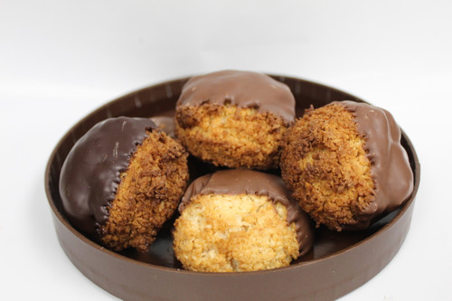 A Sweet Coconut Cookie baked to perfection and then dipped in Chocolate!