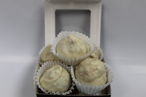 Handmade Chocolate Cream Center Dipped in White Chocolate with Toasted Coconut!