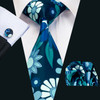 Aqua green with baby blue and silver floral pattern necktie set.