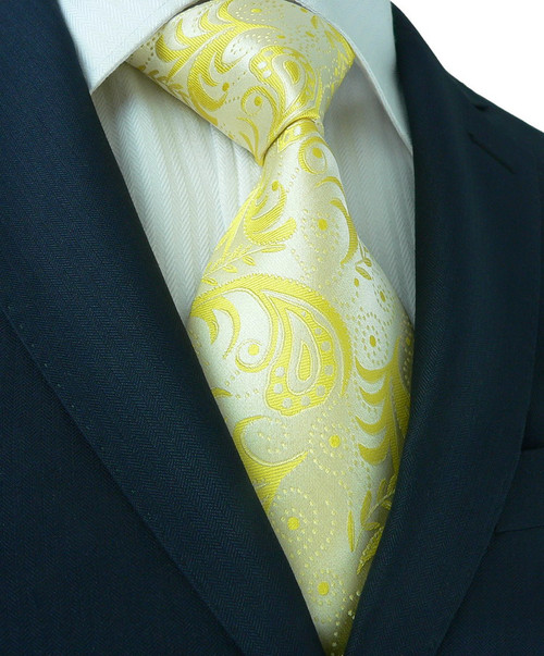 Silver with yellow floral and paisley pattern extra long necktie.
