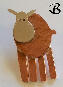 Sheep B, made into pin/brooch. Body textured copper, legs copper and head is sterling silver.