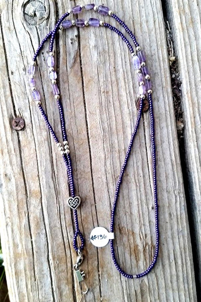 A quality lanyard made with high quality parts. This lanyard is made with glass or ceramic beads and base metal beads or sterling silver over copper bead accents throughout.
