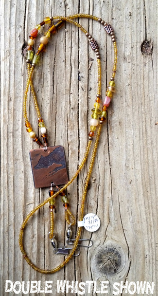 Original herding designs in etched copper and sterling silver made into unique one-of-a-kind lanyards.