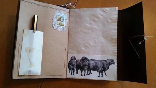 Book first few pages with vintage sheep group and pen holder
