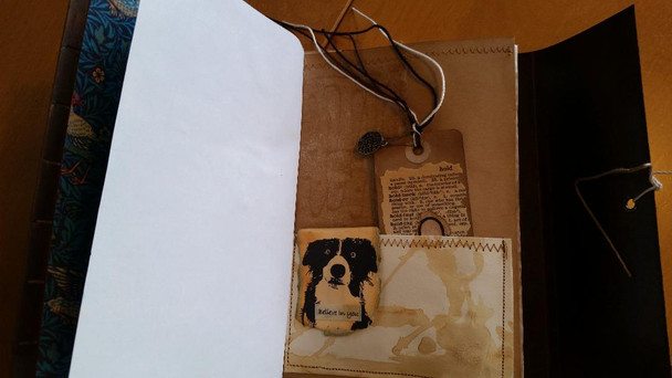 Collaged tag inside pocket and inspirational quote on Border collie clip