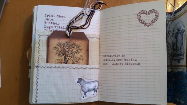 Tag inside grid paper pocket and decoupaged vintage sheep