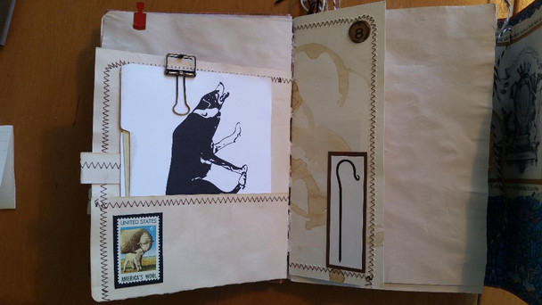 Other side of decorated sewn page, inside pocket has mini file folder with journal paper inside, sewn tab and sheep stamp.  Other partial page has a crook digital stamp and a faux vintage typewriter key.
