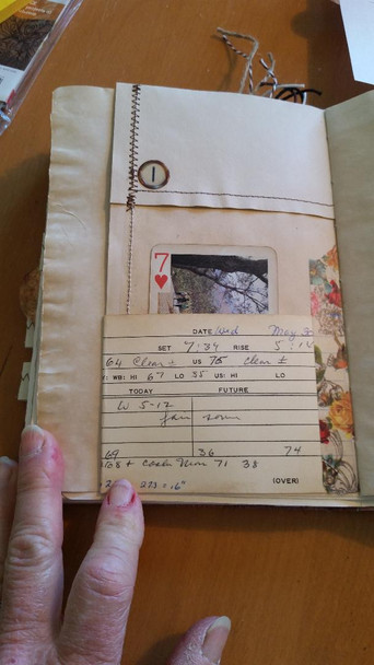 Pocket with vintage ephemera index card, inside is vintage playing card and at top of page is a faux vintage typewriter key