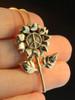 14k gold flower power peace pendant
